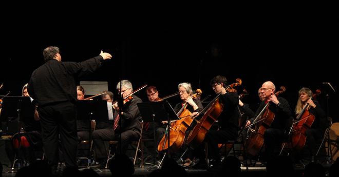 Dino gesturing to cellos